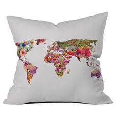 """Add a pop of style to your sofa, arm chair, or windowseat with this delightful pillow, showcasing a floral world map.  Product: PillowConstruction Material: Woven polyester cover with polyester fillColor: MultiFeatures:  Six color dye processCustom printedFloral motifDesigned by Bianca Green for DENY Designs Dimensions: 16"""" x 16""""Cleaning and Care: Spot treatment with mild detergent"""