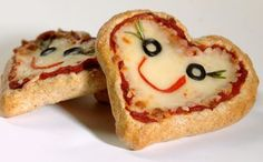 Miniature whole wheat heart-shaped pizza for Valentine's Day. Use a heart cookie cutter to shape the dough.
