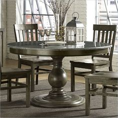 About This Product:This incarnation of the Karlin dining table feat...