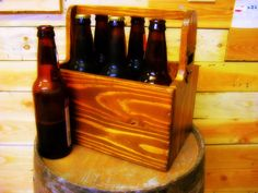 Upcycle Hand made wooden six pack holder with built in bottle opener. $45.00, via Etsy.