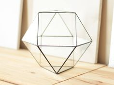 Meet Cuboctahedron! Large geometric glass terrarium featuring one of the most charming Archimedean solids in geometry. • Handcrafted from 2 mm clear glass • One side open for air circulation and easy access • Displayed either with the opening at the top or on the side • Comes with four finishing options • Colored with homemade patina formula • Finished with premium quality carnauba wax for long-lasting shine • Securely packaged with lots of bubblewrap  MEASUREMENTS:  Inches: 9 tall by 10…