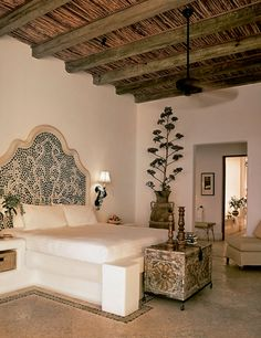 a neutral Moroccan bedroom with an ornate bed, a carved wooden chest with decor and a potted plant - DigsDigs Moroccan Bedroom, Moroccan Interiors, Moroccan Decor, Oriental Bedroom, Moroccan Lanterns, Mexican Bedroom Decor, Spanish Style Homes, Spanish House, Spanish Tile