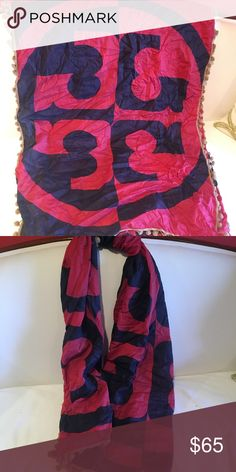 Authentic Tory Burch Pink and Navy Scarf Very gently used authentic Tory Burch Scarf in hot pink and Navy.  It has beige trim.  Worn only a few times.  Just a little wrinkled.  I did detach the tag from the scarf because it irritated my neck. Tory Burch Accessories Scarves & Wraps
