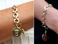 The wedding present from Camilla-a gold charm bracelet with Kate's official monogram on one side, and Camilla's (in second pic with circle around it) on the other.