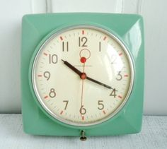 Seafoam green clock - http://data.whicdn.com/images/18504801/il_570xN.291343293_large.jpg