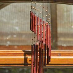 Repair wind chimes using replacement nylon string.