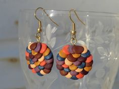 Blue and coral and brown disc earrings for sale $17