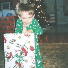 Nothing cooler than an old photo of Jim Carrey opening Christmas presents.