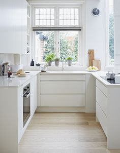 Handless kitchen by John Lewis Of Hungerford. This narrow galley kitchen is streamlined and bright, making it feel bigger than it is. Open Galley Kitchen, Galley Kitchen Design, Small Galley Kitchens, Galley Kitchen Remodel, Narrow Kitchen, Kitchen Rug, Kitchen On A Budget, Kitchen Cupboards, Home Decor Kitchen