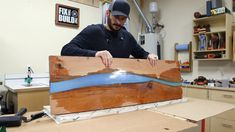 How to build a DIY epoxy resin river table with waterfall feature from a live edge slab. I'll show you how to pour thick epoxy resin pours, how to cut a waterfall joint, and how to finish an epoxy river table. Diy Resin River Table, Epoxy Wood Table, Slab Table, Wood Tables, Diy Resin Projects, Diy Waterfall, Diy Epoxy, Wall Mounted Shelves, Wood Bedroom