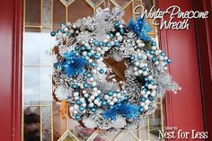 Winter {blue & silver} Pinecone Wreath: use clearance Christmas decor & spray paint the pinecones silver. From How to Nest for Less