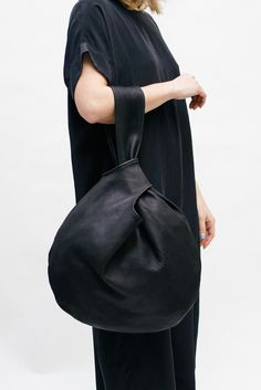 Black leather handbag, chic minimalist bag // Elizabeth Suzann... love the dress too