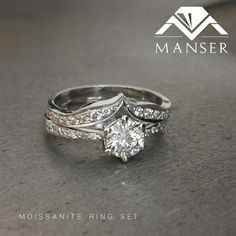 White gold engagement ring set with a centre moissanite. Custom made fitted wedding band.