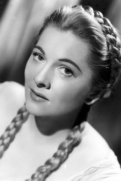 Promotional studio headshot portrait of American actor Joan Fontaine, wearing her hair in long braids for her role in director Richard Thorpe's film, 'Ivanhoe'. Get premium, high resolution news photos at Getty Images 1940s Hairstyles Short, Vintage Hairstyles, Braided Hairstyles, Wedding Hairstyles, Braided Updo, Milkmaid Braid, Plaits, Medium Hair Styles, Long Hair Styles