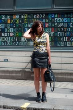 Doc Martens with lettered top and leather skirt.