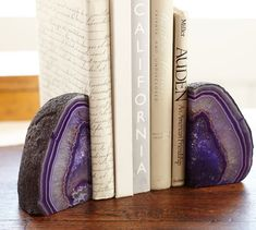 Adorn your décor with a decorative display of natural elements with our Agate Bookends. Impressively distinct, each geode is a one of a kind piece created from nature Furniture Near Me, Deck Furniture, Gifts For Bookworms, Gifts For Friends, Geode Bookends, Purple Agate, Agate Geode, Office Accessories, Nature Decor