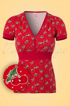 This 50s Village People Carries Cherries Top is cherrylicious!Sunshine, sunglasses, a large milkshake and this cutie... let those warm days begin! The juicy cherry and strawberry print, white pin dots , cute cherry application and short puffed sleeves make her an indispensable item. Made from a stretchy bright red cotton blend for a beautiful fit. I love you 'cherry' much!    V-neckline Short puffed sleeves Red piping Broad waist band Cherry application at the bust L...