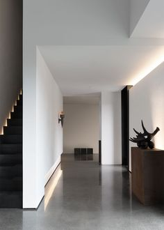 Concrete floors and stark white walls coupled with back lighting on the stairs and walls are perfect! Home Room Design, Home Interior Design, Interior Architecture, House Design, Layered Architecture, Flur Design, Hall Design, Style At Home, Interior Minimalista
