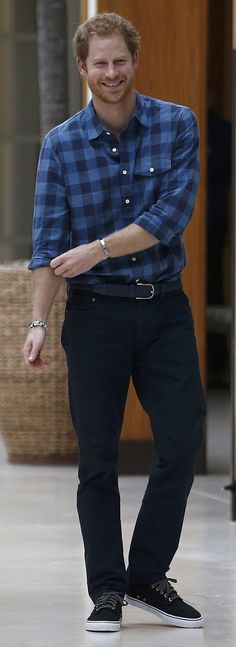 Prince Harry wore jeans and a blue checked shirt to watch a rehearsal of the 'Joyful Noise' choir, a creation of NAZ, a sexual health charity for minority communities, at The Hurlingham club on November 15, 2016 in London, England