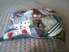 Crazy quilted pillow with a denim backing from old jeans by Creative Hands #sewing #denim #quilting #upcycling #pillows