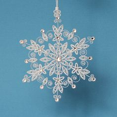This quilled / filigree sparkler Lighting up the World snowflake makes a wonderful Christmas holiday tree ornament. The snowflake has been