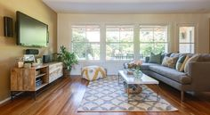 Tile Dhurrie Rug + Rustic Storage Media Console + Jackson Sectional + Bazaar Pouf from west elm