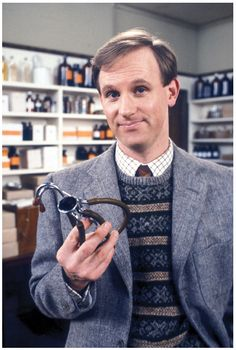 Peter Davison in costume as Tristan Farnon on the BBC television series All Creatures Great and Small. He is also known for playing the Fifth Doctor on Doctor Who. James Herriot, Peter Davison, Detective, Connie Willis, Catch Feelings, Miss Marple, Sports Uniforms, British Actors, British Comedy