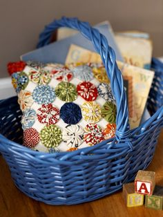 Learn two great ways to make yo-yos for this sweet little accent pillow.