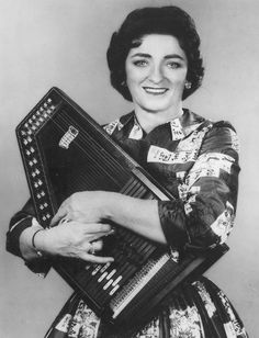 "Maybelle Carter, courtesy of Bryant Label. Maybelle Carter was one-third of country music's original first family, the Carters. She toured with her daughters, Anita, Helen and June during the 1950s and 1960s as ""Mother Maybelle and the Carter Sisters"", frequently touring with Johnny Cash, her son-in-law Classic Country Artists, Country Western Singers, Country Musicians, Johnny Und June, Johnny Cash June Carter, Music Mix, Folk Music, My Music, Carter Family"