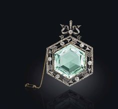 A gold and platinum-mounted Aquamarine and Diamond pendant brooch