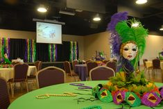 This was a Mardi Gras themed rehearsal dinner. They used green, purple and yellow/cream table cloths topped with masks and beads. The stage include Mardi Gras colored metallic and high top tables surrounded the dinner tables for the pre-dinner drinks.