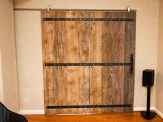 A sliding barn door adds an industrial touch to this combined living and dining space. The rustic wood of the door provides a nice contrast to the polished hardwood floor.