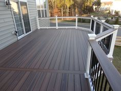 Dark floor boards and with white posts and rails