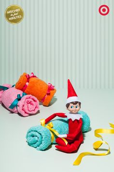Crazy Comfy Candy: Do towels REALLY belong on the towel bar? Our Elf On The Shelf sure doesn't think so. By simply adding a little ribbon, he's put a new twist on towels and transformed them into oversized plush Christmas candies.