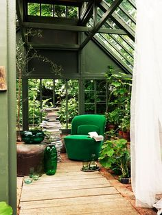 Green velvet chair in a greenhouse = ♥ Photo: J. Ingerstedt
