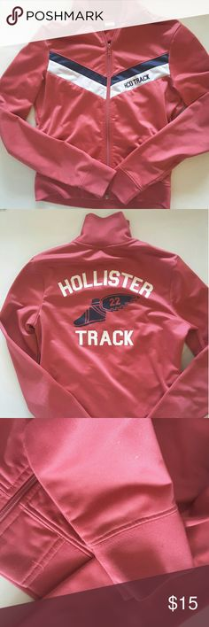 Hollister track jacket Hollister zip up track Hermes foot and # 22 on the back 2 outer pockets answer 2 inner pockets  very small spots and bon one on the sleeve pictured in last picture 16.5 inches from armpit to armpit 21 inches from shoulder to bottom of jacket Hollister Jackets & Coats