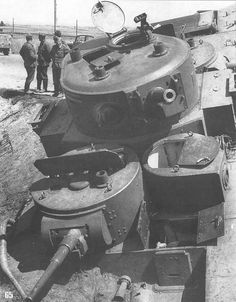 Abandoned T-35 being inspected by German troops