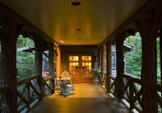 We have to build a covered walkway from our garage to the cabin - why not like this N.C. Lake House?