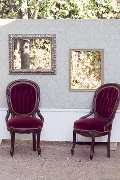 DIY photo booth wall (borrowed grandmother's chairs).