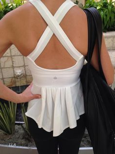 Lulu lemon running tank in a cream white with and open crisscrossed back