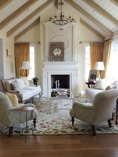 White painted wood fireplace mantel.  Love!  Fireplace. Wood mantel traditional french country