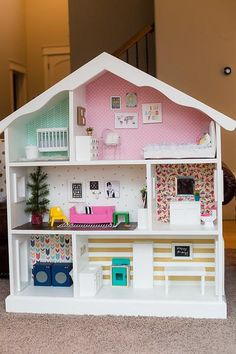 And OH how I WISH I lived in a Barbie world! Gaze upon this one of a kind handmade dollhouse that my talented friend Amber Schmidt crafted for her daughter Stel