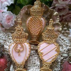 Perfume bottles in pink by Teri Pringle Wood