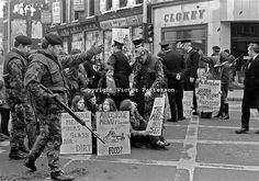 Wives & girlfriends of IRA internees held on the prison ship, Maidstone, protest in the centre of Belfast. Police and soldiers in attendance...