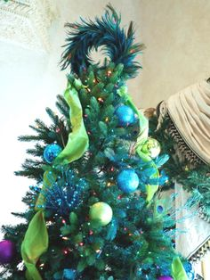 Decorating. Witching Unique Christmas Tree Toppers Ideas Come With Round Shape Blue Green Colors Peacock Feathers And Colorful Led Lights Plus Green Ribbons Along With Blue Green Purple Colors Christmas Ball Ornaments. Beautiful Design Of Unique Christmas Tree Toppers Ideas