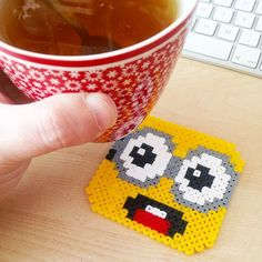 I used to love perler beads as a kid....Minion coaster hama beads by mariabi74