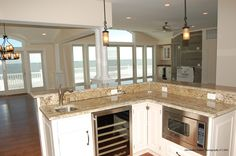 Islands and stainless steel appliances are going to be very popular this summer.  Energy efficient appliances are also gaining popularity as more Americans are joining the green trend.