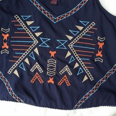 NWT Navy Embroidered Crop Boho Tank Brand new with tags. Available in sizes medium, large and XL. Retail $35.99. PRICE FIRM Tops Tank Tops