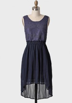 Clock Strikes Twelve Lace High-low Dress 53.99 at shopruche.com. Shimmery violet lace and crocheted applique detailing comprise the top of this lovely semi-sheer navy pleated dress. Finished with a high-low skirt and an elastic waistband for a defined silhouette.