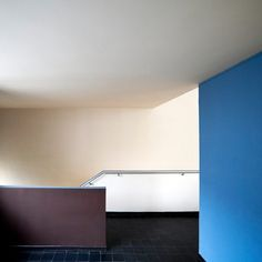 """Completed in 1925 Maison La Roche. """"The interior finishes are in-keeping with Le Corbusier's style of block-coloured walls, in shades of gray, blue and sienna."""